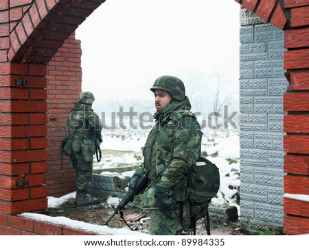 TUZLA, BOSNIA - JAN 26: United States Army troops, in Bosnia as part of NATO's IFOR,  protect a front-line headquarters position near Tuzla, Bosnia, on Thursday, January 26, 1995. - stock photo