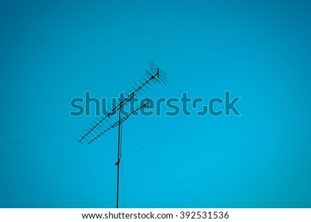 TV antenna and blue sky , process in vintage style - stock photo