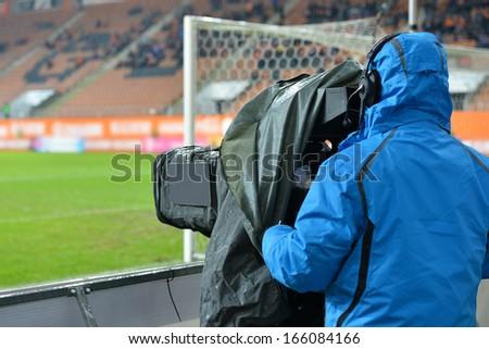 TV camera at the football stadium - stock photo