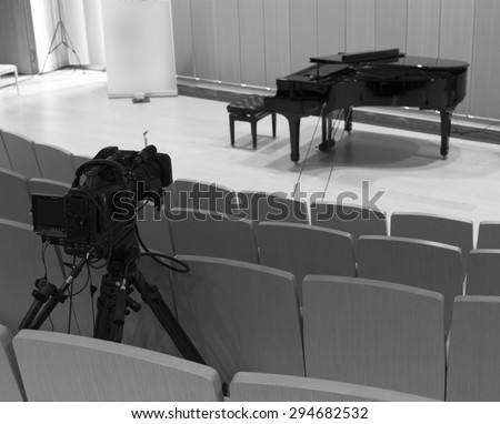 tv camera in a concert hal. Professional digital video camera. black and white photo   - stock photo