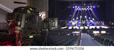 tv camera in a concert hall  - stock photo