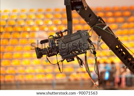 TV camera on a crane in studio - stock photo