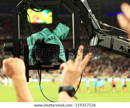 TV Camera shoots fans sector during Match S - stock photo