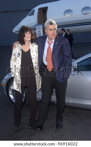 TV chat show host JAY LENO & wife MAVIS at charity event at Santa Monica Airport for The Robb Report's Best of the Best: Los Angeles. August 28, 2004 - stock photo