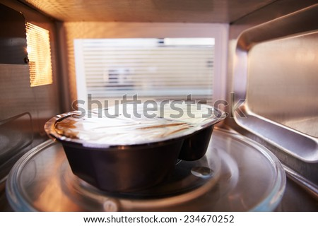 TV Dinner Cooking Inside Microwave Oven - stock photo
