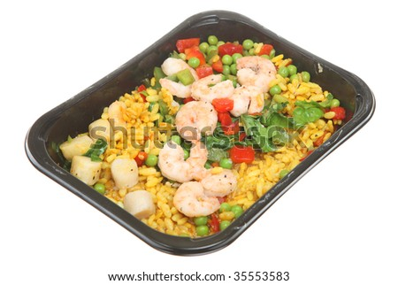 Tv dinner of paella with king prawns and scallops - stock photo