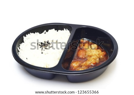 tv dinner of rice and teriyaki chicken - convenience food - stock photo