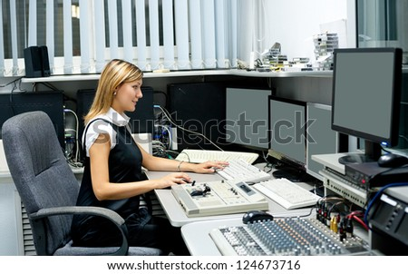 TV director (young woman) at editor in studio - stock photo