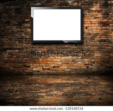 Tv in the brick wall room - stock photo