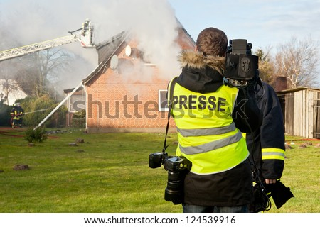 TV interview at house fire - stock photo