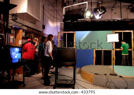 TV production crew preparing studio set.