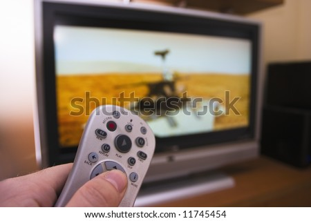 TV remote searching for a science channel - stock photo