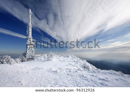 TV Repeater with ice and nice sky - stock photo