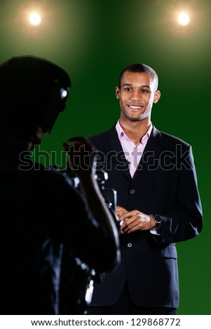TV Reporter in a Green Screen Studio - stock photo