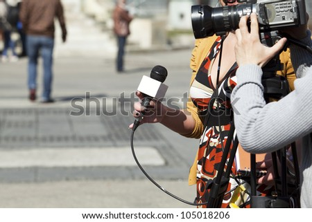 TV reporter interview - stock photo