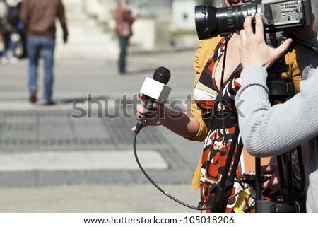 TV reporter interview - stock photo