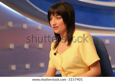 TV reporter presenting the news in studio