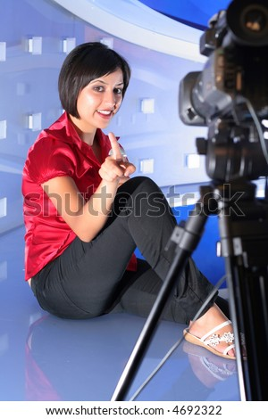 TV reporter with microphone showing the finger - stock photo