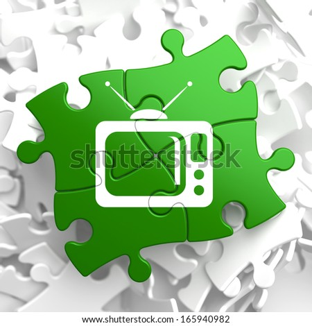TV Set Icon on Green Puzzle. Television Concept. - stock photo