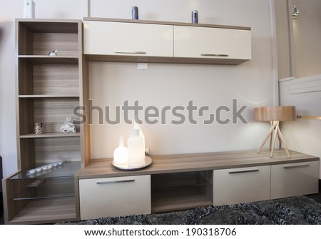 TV shelf unit cabinet on wall in lounge of furniture show room - stock photo