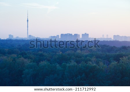TV tower and urban houses in early blue and pink sunrise in summer morning, Moscow - stock photo