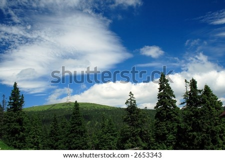 TV transmitter with restaurant on a mountain top - stock photo