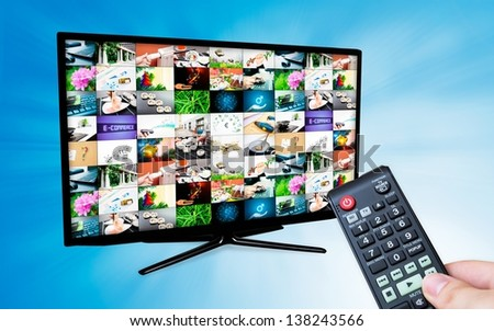 TV with multiple images gallery on blue background. Hand hold remote control