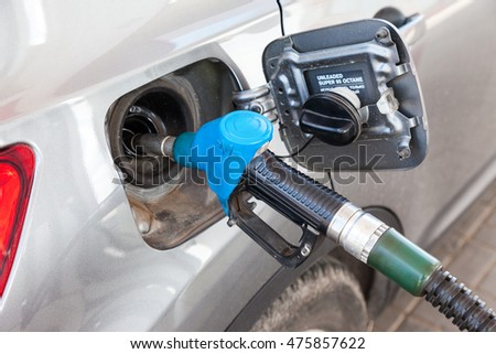 TVER REGION, RUSSIA - JUNE 26, 2016: Pumping gasoline fuel in passenger car at gas station