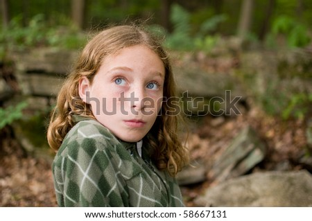 tween girl looking sideways with a humorous expression