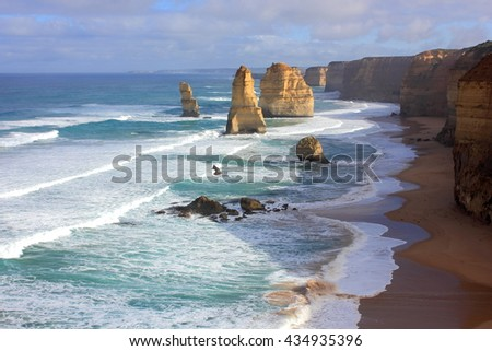 Twelve Apostles seascape along the great ocean road in Australia in morning sunlight - stock photo