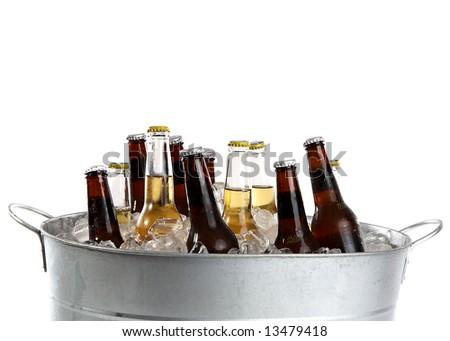 twelve cold beers in a metal bucket - stock photo