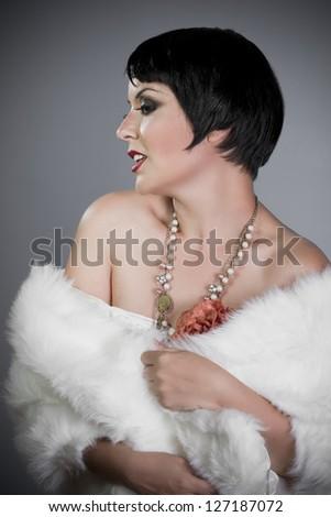 Twenties young, brunette girl in 20-s style. - stock photo