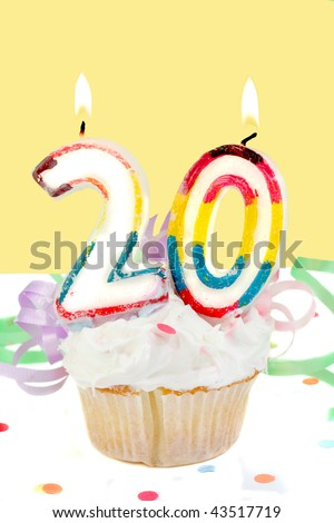 twentieth birthday cupcake with white frosting and yellow decorative background