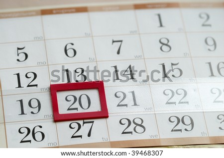 Twentieth Tuesday with red plastic mark frame on calendar macro shoot