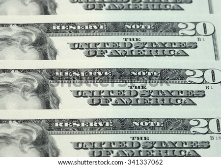 Twenty dollar bills arranged in stack - stock photo