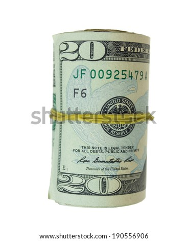 Twenty dollar bills rolled up with rubber band isolated on white - stock photo