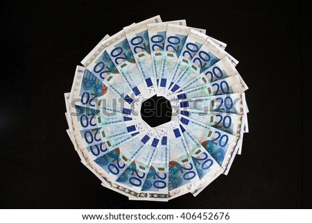 Twenty euro banknotes on black background - stock photo