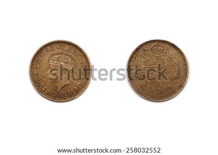 Twenty-Five cents coin from Ceylon dated 1943 showing the former King and  Emperor of India, King George the sixth. - stock photo