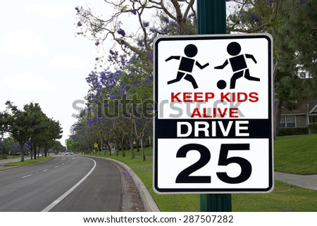 twenty five mile per hour speed limit in residential areas sign with image of children playing with a ball. Sign says keep kids alive drive 25 - stock photo