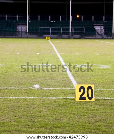 Twenty yard line marker on a football field - stock photo