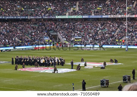TWICKENHAM LONDON - FEB 12: Band performing National anthems at England vs Italy, England playing in white Win 59 -13, at RBS Six Nations Rugby Match on February 12, 2011 in Twickenham, England. - stock photo