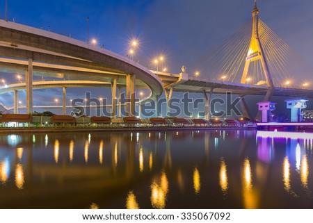 Twilight at Suspension bridge and road interchange river front view