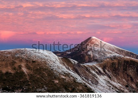 Twilight Mountain View Winter Landscape before Sunrise Forest and Snow on Hills and Summit rose color clouds on Sky - stock photo