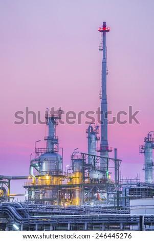 Twilight of industrial petroleum plant   - stock photo
