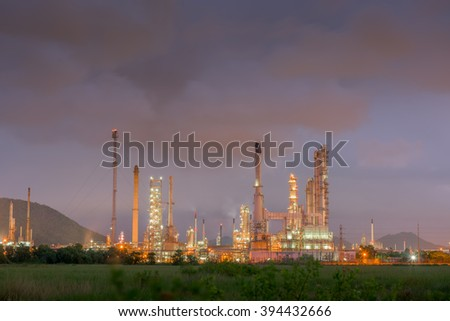 Twilight of oil refinery plant, Cloud black.