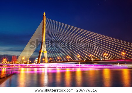 Twilight of Rama 8 bridge, the famous landmark in Bangkok, Thailand - stock photo