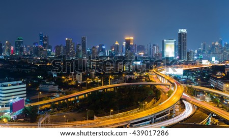Twilight over highway intersection with city downtown background