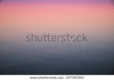 Twilight sky effect reflected on a lake calm water surface - stock photo