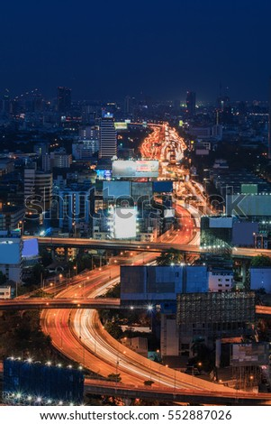 Twilight sky over curved long exposure highway interchange in Bangkok downtown Thailand