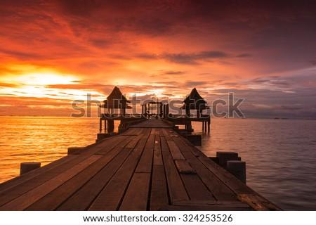 Twilight sunset wood bridge at Djittabhawan Temple tourist attraction in Pattaya, Thailand - stock photo